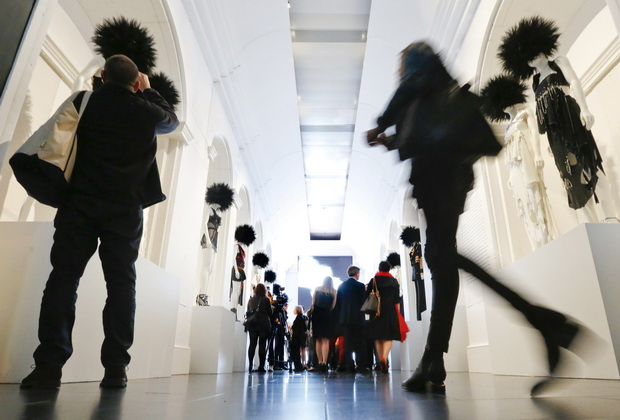 """Visitors view the Metropolitan Museum of Art's exhibit, """"Punk: Chaos to Couture,"""" in New York"""