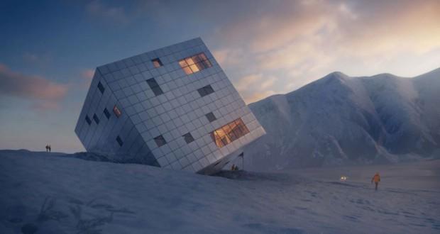 Планински објект како превртена коцка завеана во снег