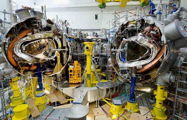 Mechanics work on the research reactor 'Wendelstein 7-X' at the Max-Planck-Institute for plasma physics in Greifswald, Germany, 10 November 2011. 520 staff members of the institute manufacture the nuclear fusion reactor experiment 'Wendelstein 7-X', which