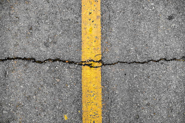 Crack on line yellow on road textured