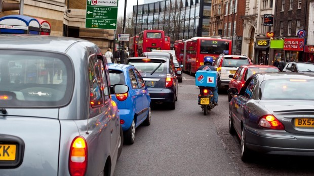A queue of cars stuck in a heavy traffic jam, Islington High St, London, Greater London, England, UK