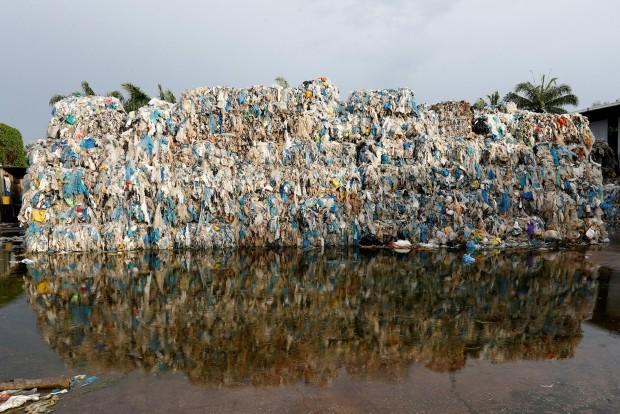 Plastic waste piled outside an illegal recycling factory in Jenjarom, Kuala Langat