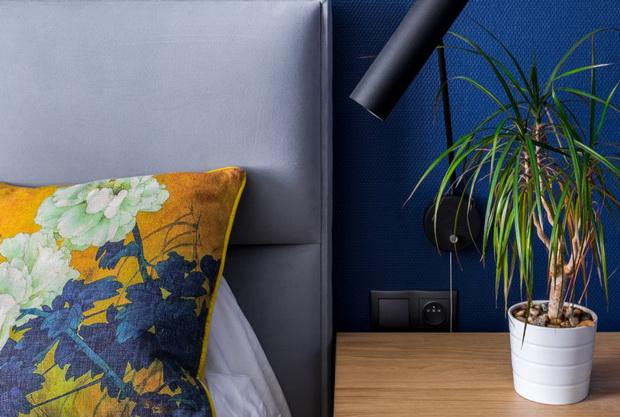 Bedroom with cobalt blue wallpaper