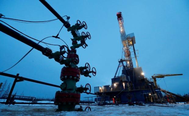 FILE PHOTO: A well head and drilling rig in the Yarakta Oil Field, owned by Irkutsk Oil Company (INK), in Irkutsk, Russia