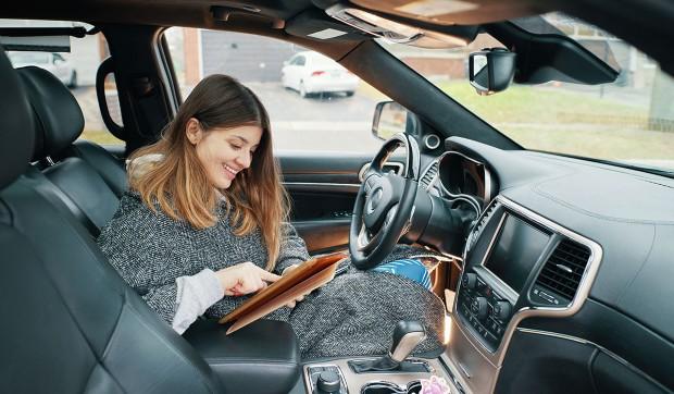 Woman enjoy her self-drive car